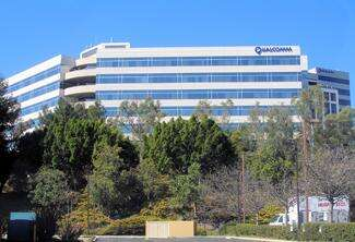 Patents and a big push to spread its cellular technology have pushed  Qualcomm into a position where it threatens Intel's No. 1 chip position.