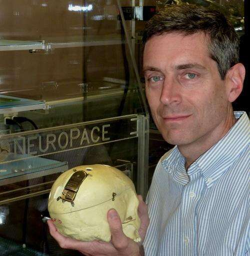 Steve Archer shows a prototype RNS implant in a skull.