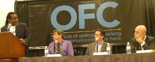 At an OFC 2015 panel session, Facebook's Yuval Bechar (second from left) told moderator Daryl Innis (left), Greg Fish (second from right) and Flavio Benetti (far right) that Facebook needs to increase data rates while lowering network costs.