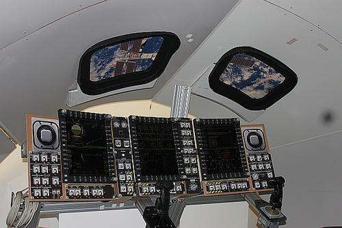 A mock-up of what will be in front of the astronauts with the 'glass cockpit' and 'edge keys' on the perimeter of each of three screens. The Space Shuttle has close to 2,000 switches and buttons and 10 panels where the Orion has just 60 manual buttons and only three screens in front of the astronauts (screens are split with an upper and lower display). The ePROC or Electronic Procedure system was designed as an alternative to reduce crew workload.