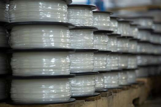Pallets of Jabil Engineered Material in filament form are prepared for shipment to Jabil customers and distribution partners.